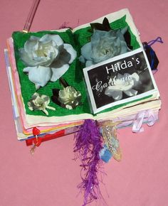 Altered Book Scrapbook - Gardenia wax chips in an envelope makes this page smell like flowers!