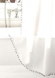 Sophisticated but fun shower curtain trimmed with Pom Poms along both sides and along the bottom.  Machine washable. Extra long sizes available: 72 x 78, 72 x 86 or 72 x 96 Please message for any other questions.   Many color options-  100% Polyester Machine washable --also available with tassels    * You can never have too much chocolate or too much pom trim....