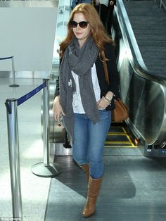 Colour co-ordinated: Amy Adams matched her leather boots and handbag to the colour of her ...