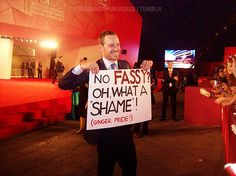 Michael Fassbender with a sign made by fans ( aka me and Giovanna ) at 68th Venice Film Festival.  (via fearthewinter)