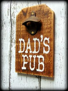 """Dad's Pub"" This rustic bottle opener sign is the perfect addition to your rustic home bar and makes a great gift for dad. This sign is handcrafted , stained, and hand painted. It is slightly distress"