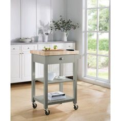 From kitchen to home coffee bar, the Sunjoy Bedford Portable Kitchen Island Cart provides the perfect blend of quality construction and contemporary. Portable Kitchen Island, Kitchen Island Cart, Butcher Block Kitchen, Kitchen Tops, Kitchen Ideas, Kitchen Furniture, Kitchen Interior, Kitchen Carts On Wheels, Coffee Bar Home