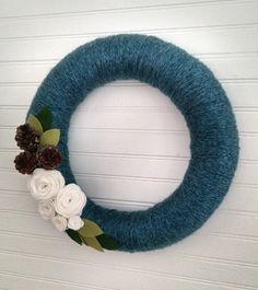 Christmas yarn wreath, blue wreath, wool felt wreath, holiday wreath, holiday decor, door decor, winter wreath, Christmas wreath by madymae on Etsy https://www.etsy.com/listing/212353998/christmas-yarn-wreath-blue-wreath-wool