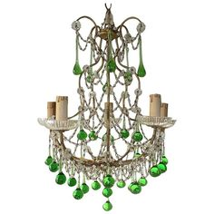 View this item and discover similar for sale at - Housing five-light, bobeches in crystal. Swags of macaroni beads and rare green Murano drops. Adding another of original chain and canopy. Re-wired Antique Chandelier, Beaded Chandelier, Chandelier Lighting, Green Chandeliers, Crystal Beads, Crystals, Amethyst Color, Contemporary Lamps, Vintage Lighting