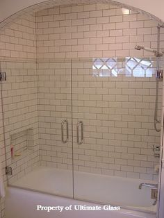 Subway tiles and frameless glass enclosed tub...gorgeous!!