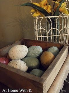 Plastic eggs covered in newspaper! But wait... add some beans inside and make them into rattlers for our little ones!