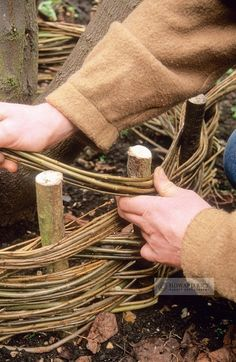 weaving willow stems around hazel uprights to form a turf seat #GardenPhotography