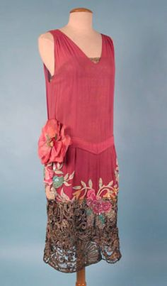 Beaded and sequined pink dress with lace hem and large pink flower at waist, c. 1926.