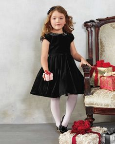 girls velvet sparkle dress - Velvet and the holidays go together like Clara and her nutcracker. This style features a smooth bodice with box-pleat skirt and sash to tie into a back bow. Rhinestones dot the collar. Dress is lined, has a tulle underskirt.