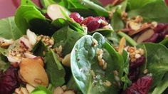 Spinach, toasted almonds, and dried cranberries are tossed with a sweet and tangy, homemade dressing creating a crowd-pleasing spinach salad.