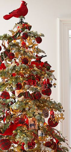 Cardinals and plaid add delicious color to this Christmas tree.