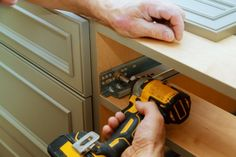 The process of refinishing kitchen cabinets is long but not that complicated once you understand the basics. Here's what you need, how to do it, and what to avoid! Grey Cabinets, Base Cabinets, Kitchen Cabinets, Real Estate Tips, Door Hinges, Home Hacks, Being A Landlord, Estate Homes, Cabinet Doors