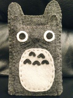 Totoro iPhone/Galaxy S case attached with a card and money holder. from SooDesignz via Etsy.