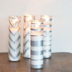 Celebrate the season with sparkling candles that cost hardly anything to make. Pick up dollar-store candles, some painters tape, and a can of metallic spray paint for quick candle transformations that make for special — and economical — holiday gifts or lovely festive decorations.