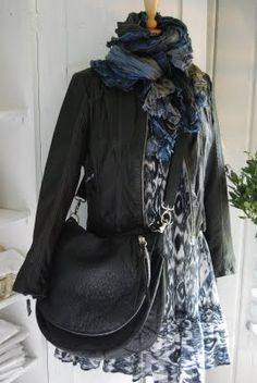 edgy and feminine... the bag seems a bit heavy but otherwise I'd totally wear.  Very cool!
