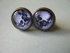 A Pair of Vintage Cool Rock Skull Ear Studs Earrings. $3.99, via Etsy.