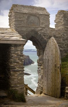 Tintagel Castle ruins of the Arthurian Legend steeped in legend and mystery; said to be the birthplace of King Arthur and Merlins Cave. Cornwall, England.