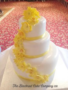 Rustic   Sweet  Yellow Summer Wedding   Wedding Cakes  Yellow     Three Tier   White   Yellow   Spring Time   Daffodil Wedding Cake