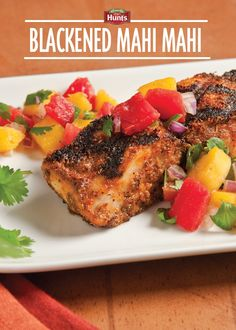 This Mahi Mahi recipe consist of blackened grilled fish served with a mango and tomato salsa – PIN and SAVE for later!