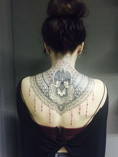 Lace inspired back/neck tattoo.
