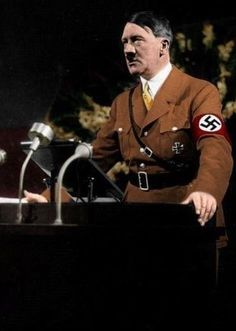 Colorized photograph of Adolf Hitler delivering a speech.