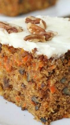 Carrot Cake Recipe Homemade Carrot Cake Recipe ~ moist, flavorful and oh so delicious… loaded with nuts, raisins, coconut and pineapple, then topped with rich and delicious cream cheese frosting! Homemade Carrot Cake, Easy Carrot Cake, Moist Carrot Cakes, Homemade Cake Recipes, Carrot Cake With Pineapple, Pineapple Coconut, Delicious Desserts, Dessert Recipes, Bolo Fit