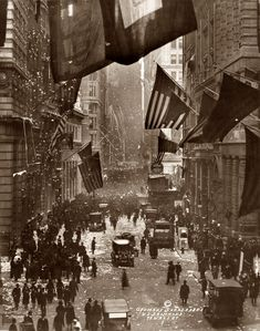 Celebration on Wall Street upon the news of Germany's surrender in World War I. November 1918. Photograph by W.L. Drummond.