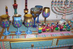 A TABLE FULL OF HAND PAINTED JUDAICA BY MSRENA
