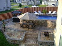 the upper pool deck allows for lounge chairs and the lower an umbrella table, bar, fire pit.