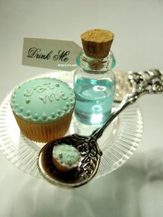 """Eat Me"" and ""Drink Me"" mini polymer clay cupcake with resin in glass bottle potion crafted by Snowfern 