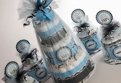 """The """" Classy Little Man"""" Mustache Diaper Cake and Set of Four Mini Diaper Cakes . Baby Shower Gift and Centerpieces. by SassyandSweetBoutiq on Etsy https://www.etsy.com/listing/177751547/the-classy-little-man-mustache-diaper"""