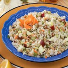 Walnut Rice Salad Recipe -Rice blends with walnuts, onions, chopped apple and a curried lemon dressing in this versatile salad. It could be a main luncheon salad in warm weather or a change-of-pace complement to a poultry or fish dinner any time of year.