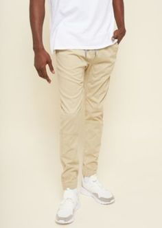 This pair of cotton twill joggers offer just the right amount of stretch and feature a drawstring waistband, back buttoned pockets, and cinched ankles. Khaki Joggers, Khaki Pants, Pairs, Pockets, Cotton, Shopping, Fashion, Moda, Khakis