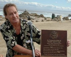 John Denver's brother Ron showing the plaque.