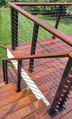 This large backyard deck and staircase catches the eye with its dramatic tigerwood and black aluminum combo. Horizontal Deck Railing, Metal Deck Railing, Outdoor Stair Railing, Balcony Railing Design, Cable Railing, Deck Stairs, Deck Balustrade Ideas, Railing Ideas, Cabin Decks
