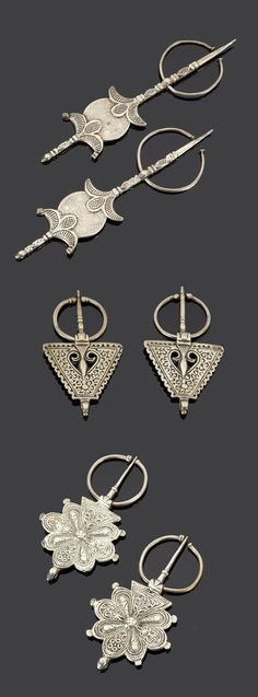 Morocco - Anti Atlas region | Three matching sets of fibulae; silver. The pieces at the top, the coins are dated 1320H./1902 et 1331H./1912 | 620€ ~ sold (May '15)