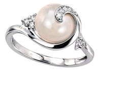 Pearl and diamond engagement ring = amazing!!
