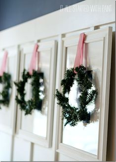 Easy decorating idea: attach dollar store wreaths to pictures.
