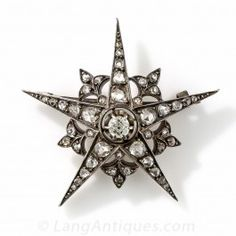 This celestial sparkler fell to earth from the night sky of mid-to-late-nineteenth century France. A bright and sparkling old mine-cut diamond, weighing .45 carat, centers five glittering rays, each of which is interposed by a diamond-set fleur-de-lys. Hand-fabricated in darkened silver over 18K rose gold. 1 and 5/8 inches, 1.70 carats total diamond weight.