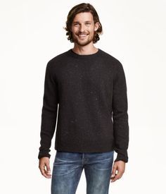 Knit sweater in a wool blend with long raglan sleeves. Rrib-knit cuffs and hem.