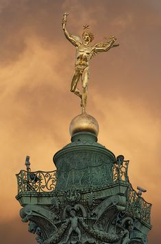 The statue le Genie de la Liberte at top of the la Colonne de Juillet in place de la Bastille, Paris