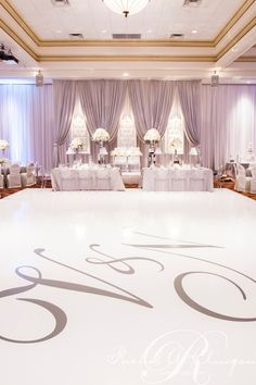 Beautiful white dance floor and silver initials. Gorgeous!