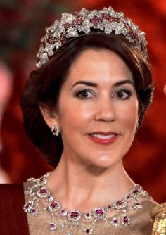 Crown Princess Mary in the Danish Ruby Parure Tiara, earrings, and necklace during the Belgian state visit to Denmark.