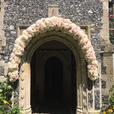 Church arch. Gorgeous floral arch of massed roses and hydrangea - bringing romance and elegance to a stylish summer wedding.