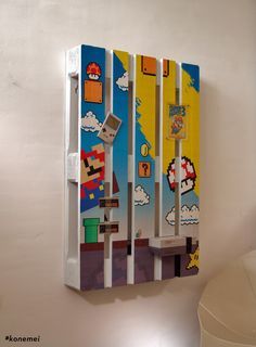 Super Mario themed pallet. NES console with controllers, Super Mario 3 and a Gameboy #konemei