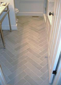 Bathroom flooring - light grey tiles in herringbone pattern Upstairs Bathrooms, Small Bathroom, Bathroom Gray, Bathroom Ideas, Bath Ideas, Basement Bathroom, Chevron Bathroom, Shower Ideas, White Bathrooms