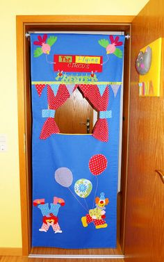 Door frame puppet theater - wouldn't need to be so complex, but we could have fun with this idea.