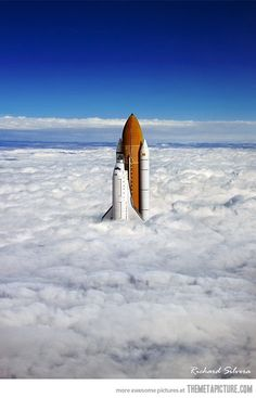 Space Shuttle breaching the clouds