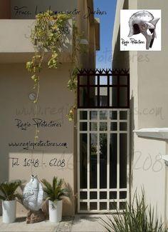 Puerta posterior, protector para ventana y agregado a puerta de pasillo, Fracc.Las Lomas sector Jardines, #333