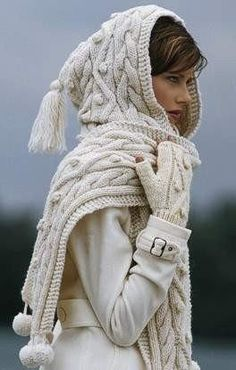 Tassels & pompoms on a cable knit hooded scarf.  Cute!